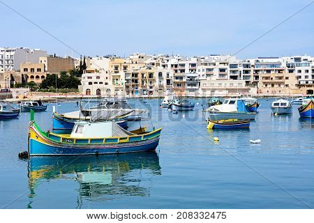 BIRZEBBUGA, MALTA - APRIL 1, 2017 - Traditional Maltese fishing boats in the harbour Birzebbuga Malta Europe, April 1, 2017.