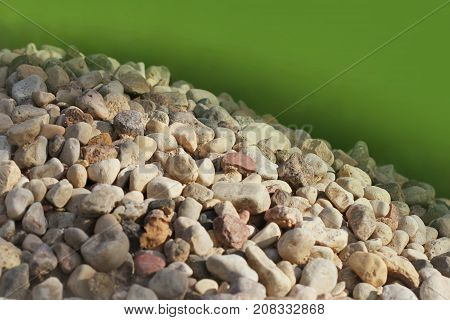 A pile of stones against the background of grass.