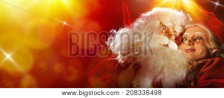 Santa Claus And Mrs Claus On Red And Yellow Background