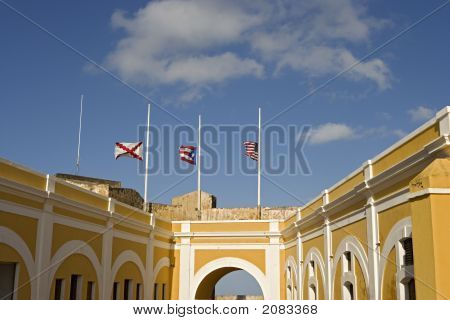 El Morro  Courtyard With Flags At Half Mast