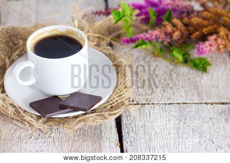 Coffe, Chocolate And Fresh Flower On White Wooden Background