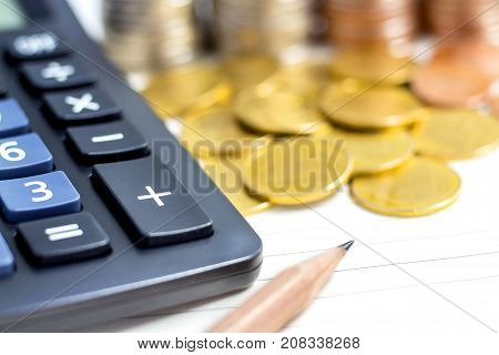 Coins stack with calculator on white table. The concept of business growth financial or money savings with copy space for text.