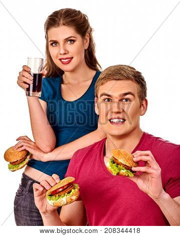 Couple eating fast food. Man and woman treat big hamburger with ham. Friends give burder junk on white background isolated. Food semi-finished products. How to feed husband.