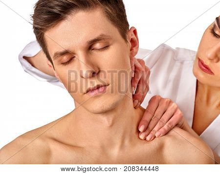 Shoulder and neck massage for man in spa salon. Doctor making therapy in rehabilitation center. Correction of dislocation of neck by experienced specialist.