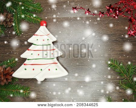 christmas festive table place setting with pine branch napkin and decoration