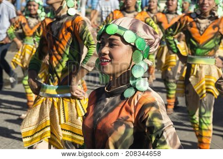 Dumaguete Philippines - 16 September 2017: Sandurot Festival actor in national clothes. Carnival street dancer in colorful costumes. Smiling people on traditional autumn parade. Philippines festival