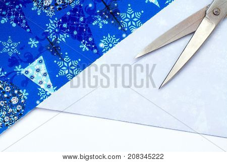 Christmas Gift Wrapping Party Time with Colorful Paper Ribbon Bows Scissors and Tape on Cyan Blue Shabby Chic Wood Board Background with Square Crop and Room or Space for copy text your words.