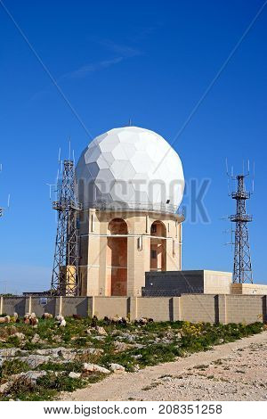 DINGLI, MALTA - APRIL 1, 2017 - View of Dingli Aviation radar station with sheep and goats in the foreground Dingli Malta Europe, April 1, 2017.