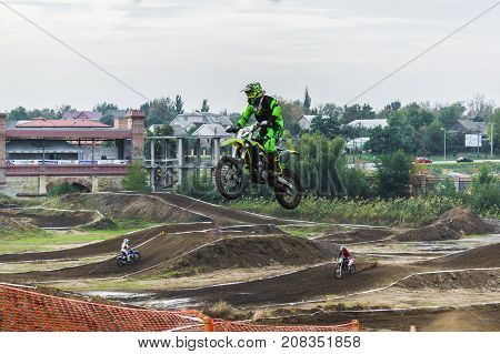 The Racer On A Motorcycle Participates In A Motocross Race, Jumps On A Springboard.