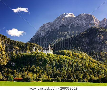 Neuschwanstein Castle With Scenic Mountain Landscape Near Fussen, Bavaria, Germany