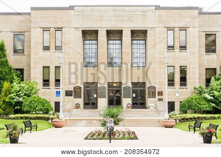 city hall municipal building of st catharines ontario canada front view park chairs lawn grass entrance