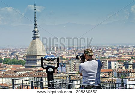 photographer shoot from viewpoint the Mola Antonelliana symbol of Turin