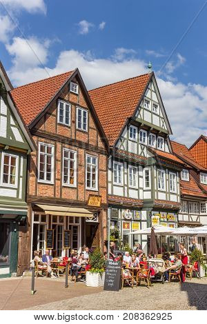 CELLE, GERMANY - MAY 21, 2017: People sitting outside a restaurant in Celle, Germany