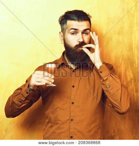 Brutal Caucasian Hipster Holding Alcoholic Shot