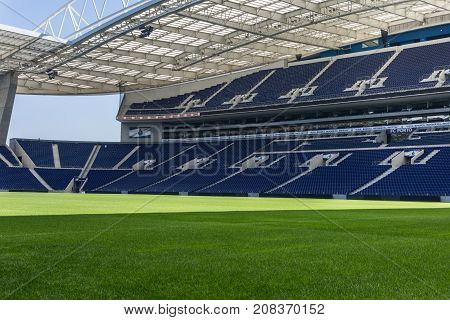 Oporto, Portugal - july 2016: Blue Seatings Green Pitch and Gallery inside Empty Stadium Before Soccer Match