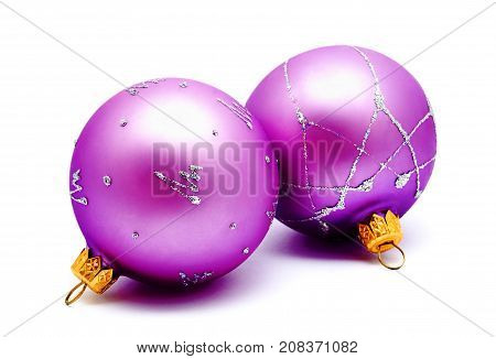 Christmas decoration lilac magenta balls isolated on a white background