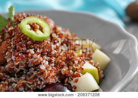 Salad with quinoa and vegetables on plate, closeup