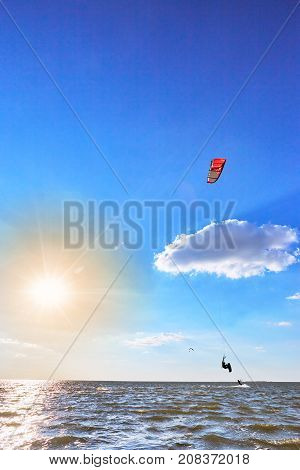 Classes on kitesurfing in the sea against a blue sky.