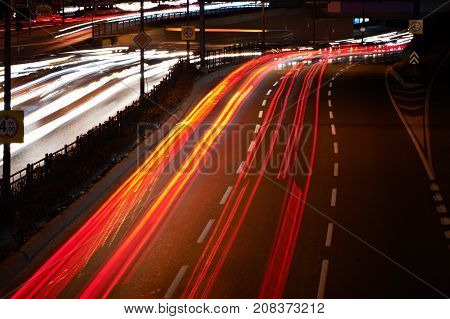 Blurred Tail Lights And Traffic Lights On Highway