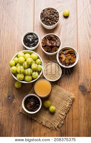 Stock photo of Amla/Avla/Aavla and it's by products like chyawanprash or chyavanprash, juice, Amla supari or mouth freshner, powder, juicy or dried sweet murabba or muramba, pickle, selective focus