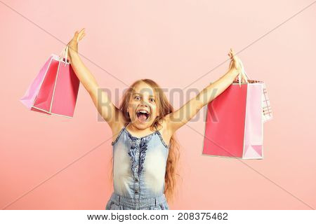 Girl With Pink Shopping Bags. Sale And Shopping Concept