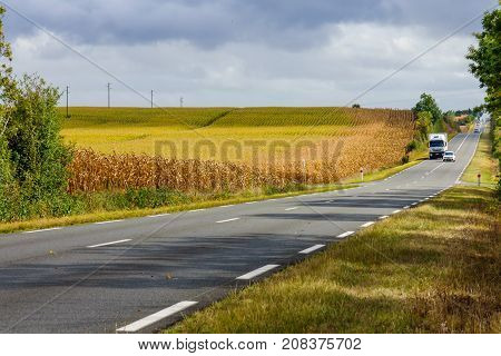 Landscape of road and countryside in the Pays de la Loire region in western France