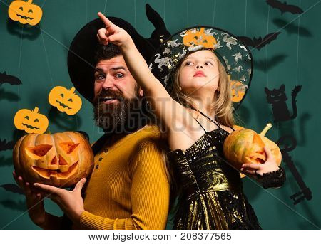 Halloween Party And Holiday Concept. Dad And Daughter In Costumes.