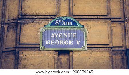 Blue Parisian Street Sign On A Stone Wall