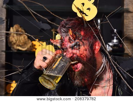 Halloween Party Concept. Man Wearing Scary Makeup Holds Beer