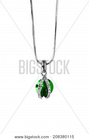 Elegant emerald and diamonds pendant on silver chain isolated over white