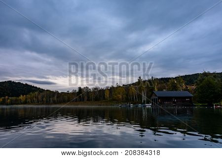 morning lake view in carinthia with reflections