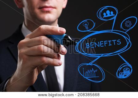Business, Technology, Internet And Network Concept. Young Business Man Writing Word: Benefits