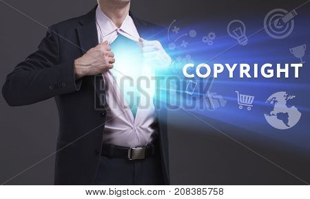 Business, Technology, Internet And Network Concept. Young Businessman Shows The Word: Copyright