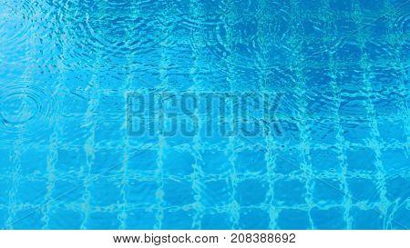 Rain Drop Falling On Swiming Pool.