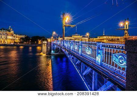 Night cityscape, Hermitage, river and bridge in Saint-Petersburg. Illuminated bridge