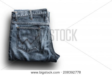 Close up top view of blue jeans isolated on white background with space use for texts or products display