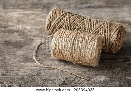 Hanks of hemp twine on wooden background