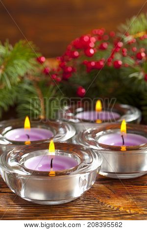 Candles And Branch Of Christmas Tree