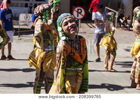 16 Sep 2017 Dumaguete Philippines - smiling actor of Sandurot festival. Philippines festival tradition. Street performance actress smiling in camera. Street dance parade in national costume