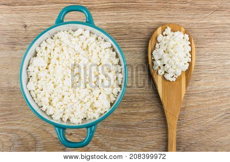 Blue Bowl And Bamboo Spoon With Grainy Cottage Cheese