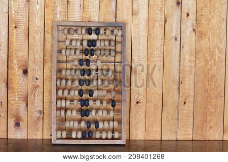 Old abacus wooden for the calculating tree calculator