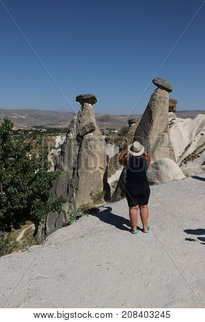 21ST JULY 2017, CAPPADOCIA,TURKEY:  Tourists visiting some of the famous Fairy chimneys in Cappadocia which were excavated by people to be used as houses and churches in turkey, 21st july 2017