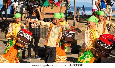 Dumaguete Philippines - 16 September 2017: street dance at Sandurot Festival. Carnival with dancing and drum music. Children in national costume. Philippines festival tradition. Autumn festival