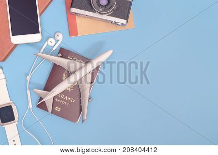 Travel gadgets and travel object on blue copy space for travel concept