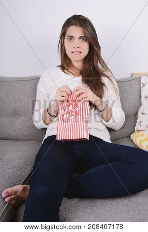 Woman Eating Popcorn And Watching Movies.