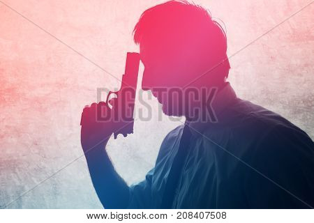 Silhouette of a man with a gun. Adult male person with handgun. Police detective spy or secret service officer armed with fire weapon