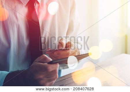 Credit card and mobile payment. Man using smartphone app to make an online bank transaction. Paying and buying on the internet with electronic banking.