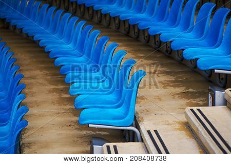Blue plastic stadium seats as repeating pattern