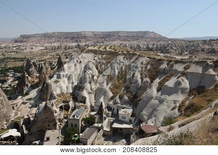 Looking down and across onto fairy chimneys ,typical geologic formations of Cappadocia, goreme ,excavated by people to be used as houses and churches