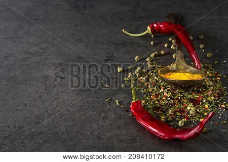 Set Of Various Spices On Black Stone Table. Chilly Pepper,  Basi
